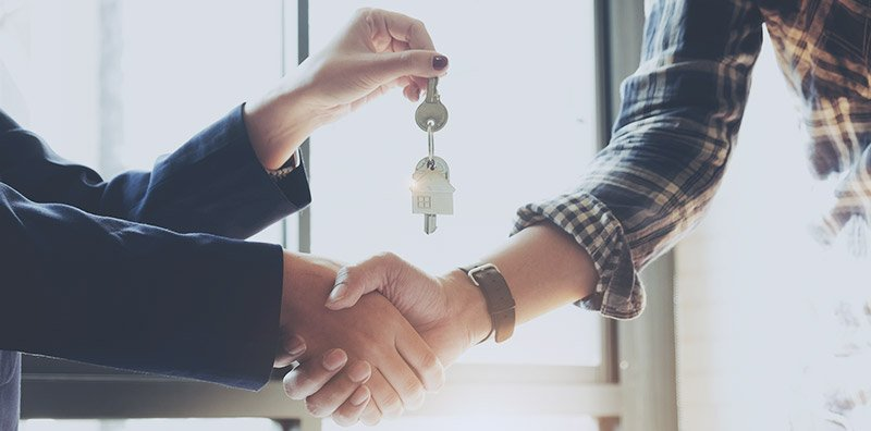 Realtor handing keys to borrower
