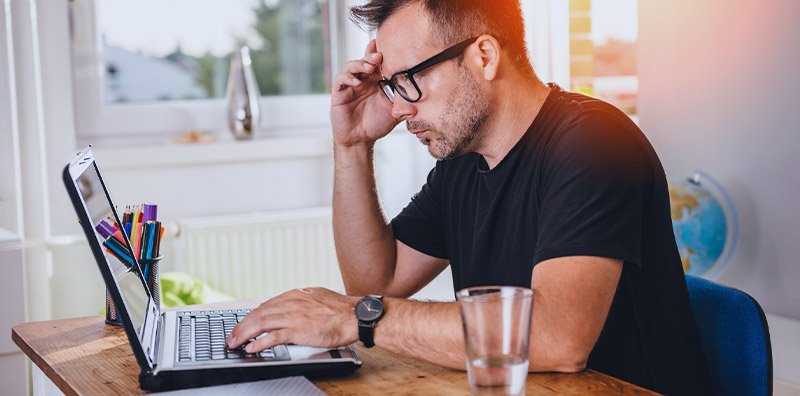 Man searching for homes online