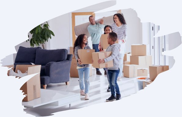 family carrying boxes into new house